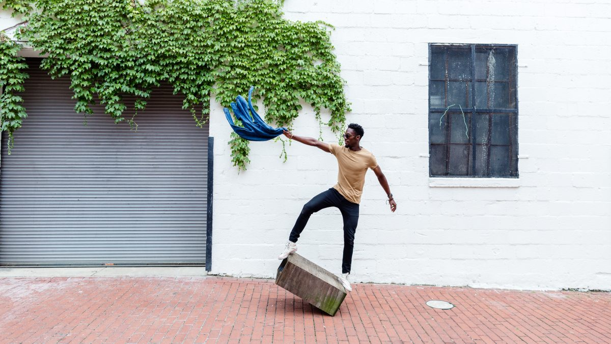Man Balancing on a Box