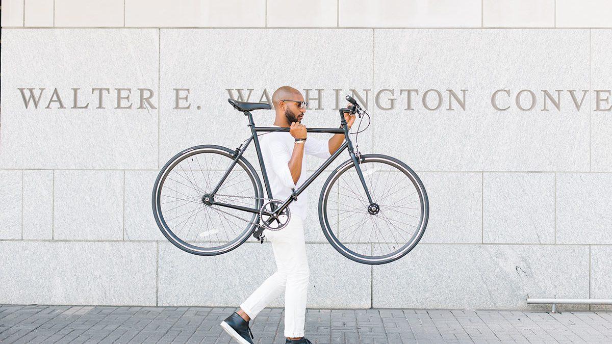 Man Carrying a Bike